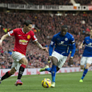 Manchester United's Angel Di Maria, left, keeps the ball from Leicester's Jeffrey Schlupp during the English Premier League soccer match between Manchester United and Leicester at Old Trafford Stadium, Manchester, England, Saturday Jan. 31, 2015