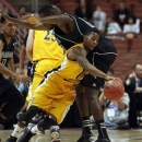 University of California-Irvine guard Derick Flowers (0) drives around Hawaii center Vander Joaquim, of Angola, in the first half of an NCAA college basketball game in the Big West Conference tournament Thursday, March 14, 2013, in Anaheim, Calif. (AP Photo/Reed Saxon)