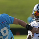 Carolina Panthers' Luke Kuechly, left, and DeAngelo Williams, right, laugh during an NFL football practice at training camp in Spartanburg, S.C., Saturday, July 26, 2014 The Associated Press