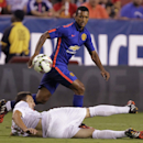 Inter Milan's Zdravko Kuzmanovic, front, falls as Manchester United's Antonio Valencia looks for the ball during the second half of the 2014 Guinness International Champions Cup soccer game, Tuesday, July 29, 2014, in Landover, Md. Manchester United won