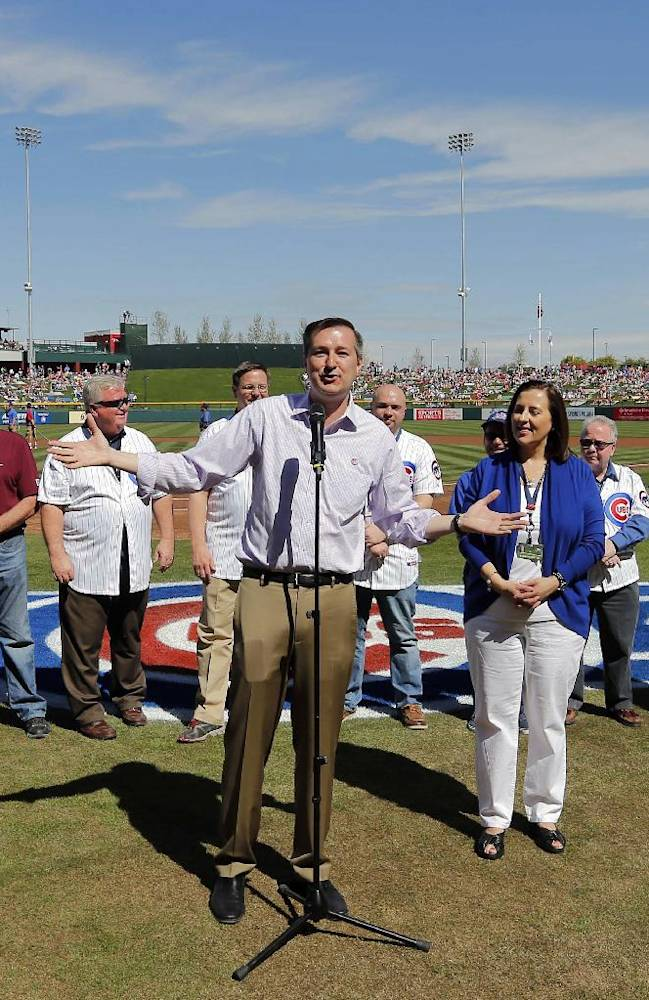 Chicago Cubs owner Tom Ricketts welcomes fans before a spring training baseball game against the Arizona Diamondbacks, Thursday, Feb. 27, 2014, in Mesa, Ariz. It was the Cubs' first Cactus League game in their new spring training facility