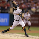 In an Oct. 11, 2014, file photo San Francisco Giants' Sergio Romo throws during the eighth inning in Game 1 of the National League baseball championship series against the St. Louis Cardinals in St. Louis. A person with knowledge of the negotiations says