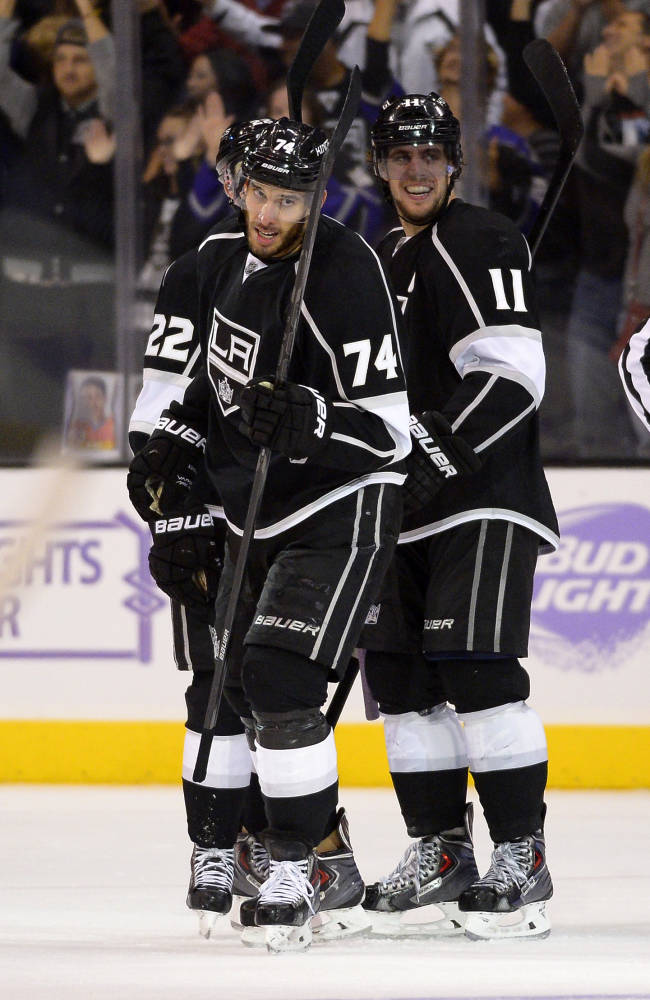 Los Angeles Kings center Dwight King, left, celebrates his third goal of the game with center Anze Kopitar, of Slovenia, during the third period of their NHL hockey game against the Phoenix Coyotes, Thursday, Oct. 24, 2013, in Los Angeles