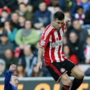 Sunderland's Anthony Reveillere, right, vies for the ball with Everton's Aiden McGeady, left, during their English Premier League soccer match at the Stadium of Light, Sunderland, England, Sunday, Nov. 9, 2014