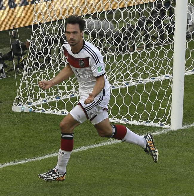 Germany's Mats Hummels celebrates after scoring the opening goal during the World Cup quarterfinal soccer match between Germany and France at the Maracana Stadium in Rio de Janeiro, Brazil, Friday, July 4, 2014