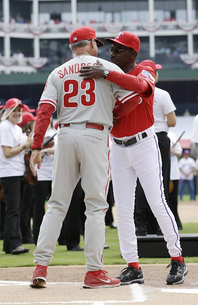 Philadelphia Phillies manager Ryne Sandberg and Texas Rangers manager Ron Washington greet each other before an opening day baseball game at Global Life Park, Monday, March 31, 2014, in Arlington, Texas