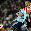 West Ham United's Diafra Sakho, left, vies for the ball with Sunderland's Wes Brown, right, during their English Premier League soccer match at the Stadium of Light, Sunderland, England, Saturday, Dec. 13, 2014