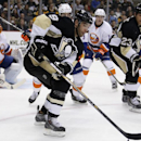 Pittsburgh Penguins' Pascal Dupuis (9) goes after a puck during the second period an NHL hockey game against the New York Islanders in Pittsburgh, Saturday, Oct. 18, 2014 The Associated Press