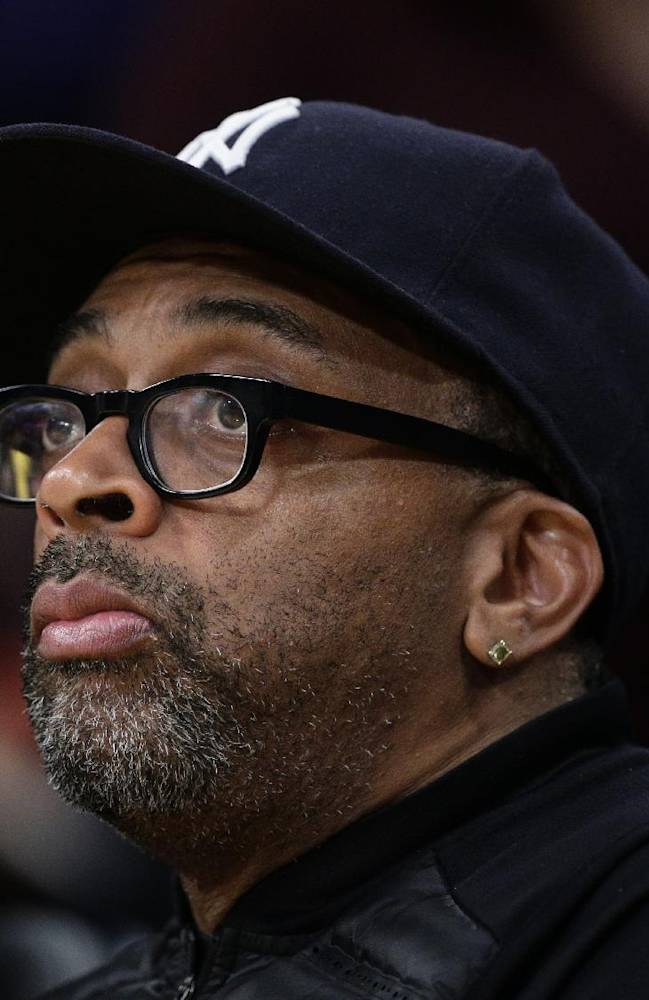 Director Spike Lee attends an NBA basketball game between the Los Angeles Lakers and the Los Angeles Clippers on Thursday, March 6, 2014, in Los Angeles