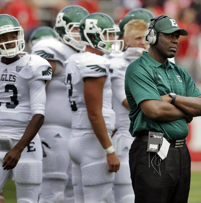 Eastern Michigan head coach Ron English watches play during the first half of an NCAA college football game against Rutgers in Piscataway, N.J., Saturday, Sept. 14, 2013.Rutgers won 28-10