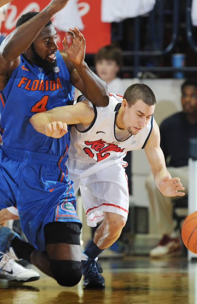 Florida's Patrick Young (4) and Mississippi's Marshall Henderson (22) go for the ball during an NCAA college basketball game in Oxford, Miss., Saturday, Feb. 22, 2014