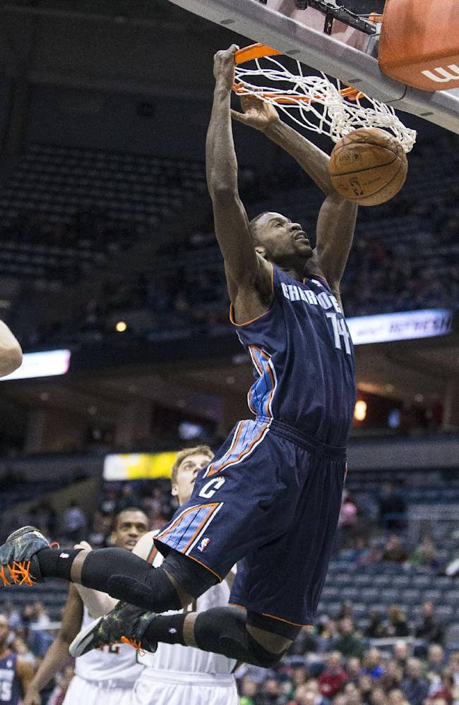 Charlotte Bobcats' Michael Kidd-Gilchrist dunks the ball against the Milwaukee Bucks during the first half of an NBA basketball game on Sunday, March 16, 2014, in Milwaukee