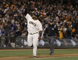 San Francisco Giants' Pablo Sandoval celebrates after hitting a two-run home run off of Washington Nationals pitcher Yunesky Maya during the tenth inning of a baseball game in San Francisco, Tuesday, May 21, 2013. The Giants won 4-2 in 10 innings. (AP Photo/Jeff Chiu)