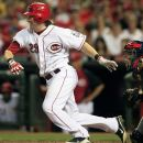 Cincinnati Reds' Ryan Hanigan watches his infield single that drove in a run in the seventh inning of a baseball game against the St. Louis Cardinals, Friday, July 13, 2012 in Cincinnati. Yadier Molina catches at right. The Reds won 5-3. (AP Photo/Al Behrman)