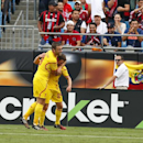 IMAGE DISTRIBUTED FOR GUINNESS INTERNATIONAL CHAMPIONS CUP - Liverpool's Rickie Lambert, left, celebrates with Joe Allen after Allen scored a point and achieved the