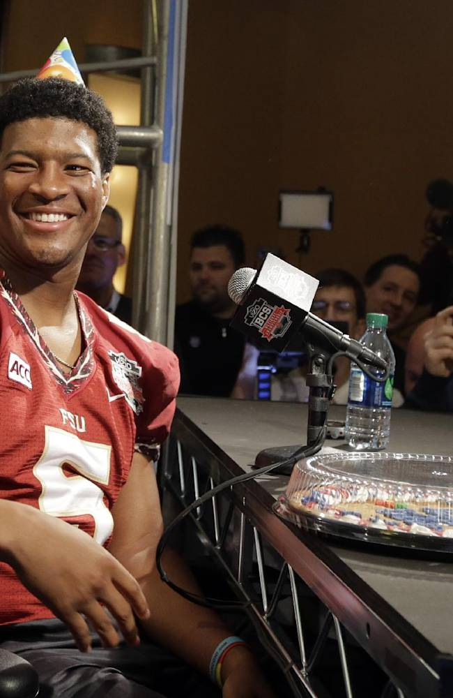 Florida State's Jameis Winston wears a birthday hat as he answers a question during media day for the NCAA BCS National Championship college football game Saturday, Jan. 4, 2014, in Newport Beach, Calif. Florida State plays Auburn on Monday, Jan. 6, 2014. Winston's birthday is Jan. 6