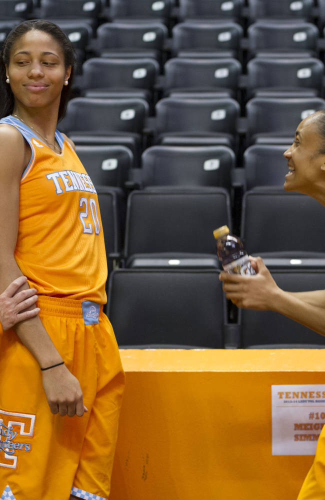 Tennessee coach Holly Warlick, left, jokes with her players Isabelle Harrison, center, and Meighan Simmons  during NCAA college basketball media day Wednesday, Oct. 30, 2013, in Knoxville, Tenn