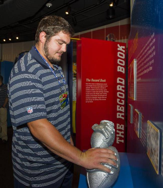 Dallas Cowboys rookie Zack Martin checks his hand size at a display during the 2014 NFL Rookie Symposium at the Pro Football Hall of Fame in Canton, Ohio, Wednesday, June 25, 2014
