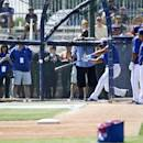 Seattle Seahawks quarterback Russell Wilson connects while taking batting practice with the Texas Rangers prior to a Rangers spring training baseball game against the San Diego Padres Saturday, March 28, 2015, in Surprise, Ariz. (AP Photo/Lenny Ignelzi)