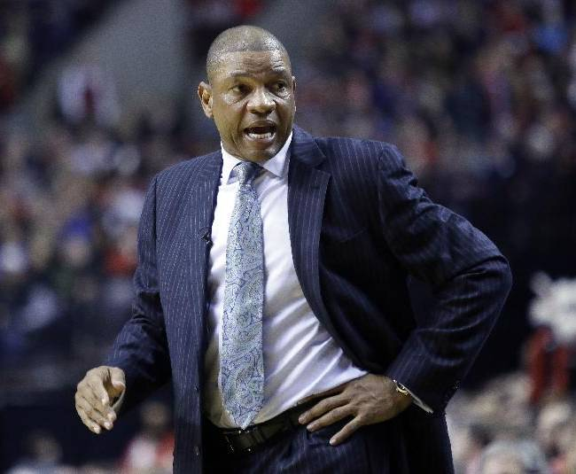 Los Angeles Clippers coach Doc Rivers looks to the bench during the first half of an NBA basketball game against the Portland Trail Blazers in Portland, Ore., Thursday, Dec. 26, 2013