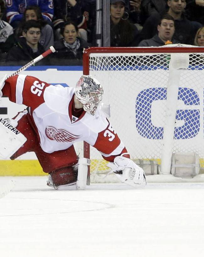 Detroit Red Wings goalie Jimmy Howard watches a puck shot by New York Rangers' Chris Kreider get past him for a goal during the third period of an NHL hockey game on Sunday, March 9, 2014, in New York. The Rangers won the game 3-0