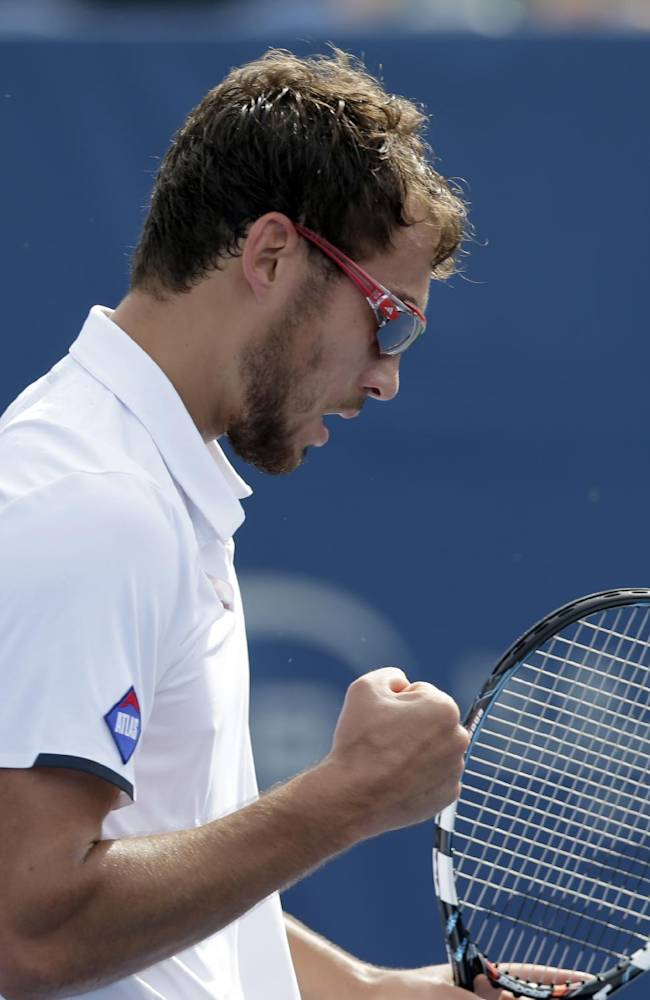 Jerzy Janowicz, of Poland, pumps his fist after winning a point against David Goffen, of Belgium, in their match at the Winston-Salem Open tennis tournament in Winston-Salem, N.C., Thursday, Aug. 21, 2014