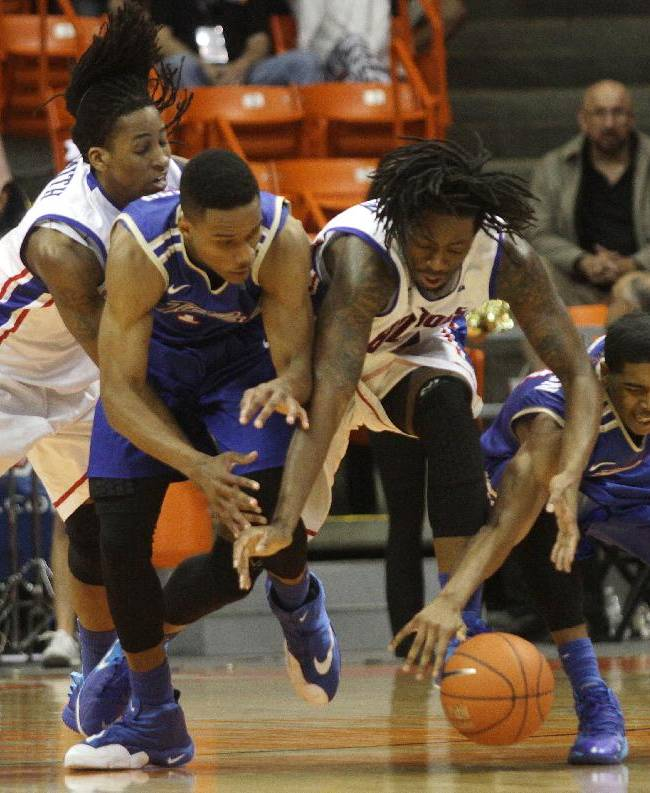 Louisiana Tech's Kenneth Smith, left, and Chris Anderson, second from right, battle Tulsa's James Woodard, second from left, and Shaquille Harrison, right, for a loose ball during the second half of their Conference USA Tournament championship game Saturday  March 15, 2014 in El Paso, Texas