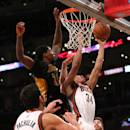 LOS ANGELES, CA - FEBRUARY 27:  Giannis Antetokounmpo #34 of the Milwaukee Bucks shoots over Ed Davis #21 of the Los Angeles Lakers at Staples Center on February 27, 2015 in Los Angeles, California.  The Lakers won 101-93.  NOTE TO USER: User expressly acknowledges and agrees that, by downloading and or using this photograph, User is consenting to the terms and conditions of the Getty Images License Agreement.  (Photo by Stephen Dunn/Getty Images)