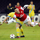 Arsenal's Laurent Koscielny is airborne as he vies for the ball with Napoli's Blerim Dzemaili, during a Champions League, group F, soccer match between Napoli and Arsenal, at the Naples San Paolo stadium, Italy, Wednesday, Dec. 11, 2013