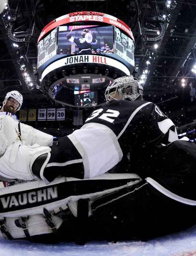 Los Angeles Kings goalie Jonathan Quick, right, blocks a shot by New York Rangers center Brad Richards during the third period of Game 1 in the NHL Stanley Cup Final hockey series Saturday, June 7, 2014, in Los Angeles