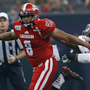 Louisiana-Lafayette quarterback Terrance Broadway (8) runs with Nevada defensive end Lenny Jones, right, in pursuit during the first half of the New Orleans Bowl NCAA college football game in New Orleans, Saturday, Dec. 20, 2014. (AP Photo/Jonathan Bachman)