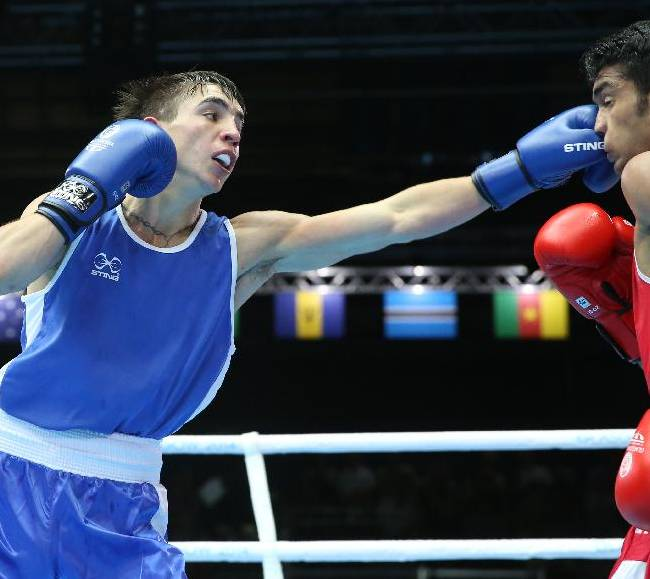 Northern Ireland's Michael Conlan, left, lands a left jab on India's Shiva Thapa, in a men's bantamweight preliminary bout, during the Commonwealth Games Glasgow 2014, in Glasgow, Scotland, Monday July 28, 2014