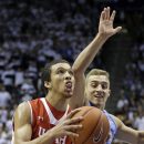Utah forward Brekkott Chapman (0) goes to the basket as BYU guard Chase Fischer (1) defends in the first half during an NCAA college basketball game Wednesday, Dec. 10, 2014, in Provo, Utah. (AP Photo/Rick Bowmer)