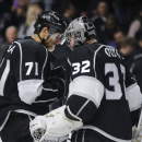 Los Angeles Kings goalie Jonathan Quick, right, and teammate Jordan Nolan celebrate the Kings' 6-1 win over the Edmonton Oilers in an NHL hockey game Tuesday, Oct. 14, 2014, in Los Angeles The Associated Press