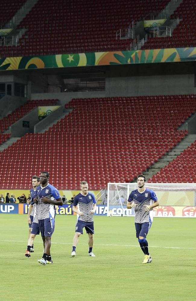Italy players jog during a training session of Italy at the soccer Confederations Cup in Recife, Brazil, Tuesday, June 18, 2013. Italy face Japan in a group A match on Wednesday