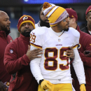 Washington Redskins wide receiver Santana Moss (89) is pulled off the field after being ejected from the game at the end of the second quarter of an NFL football game against the New York Giants, Sunday, Dec. 14, 2014, in East Rutherford, N.J The Associat