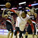 Houston Rockets' Dwight Howard, center, loses the ball as Portland Trail Blazers' Robin Lopez (42) and Nicolas Batum (88) defend during overtime in Game 1 of an opening-round NBA basketball playoff series Sunday, April 20, 2014, in Houston. The Trail Blaz