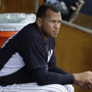 New York Yankees' Alex Rodriguez watches from the dugout during an intrasquad game at a spring training baseball workout, Monday, March 2, 2015, in Tampa, Fla. (AP Photo/Lynne Sladky)