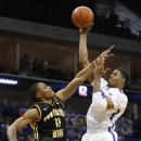 Memphis forward D.J. Stephens (30) shoots over Southern Miss forward Daveon Boardingham (11) during the first half of an NCAA college basketball game in the championship of Conference USA tournament in Tulsa, Okla., Saturday, March 16, 2013. (AP Photo/Sue Ogrocki)