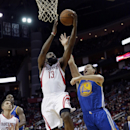 Houston Rockets' James Harden (13) goes up for a shot as Golden State Warriors' Klay Thompson (11) defends during the third quarter of an NBA basketball game Friday, Dec. 6, 2013, in Houston. The Rockets won 105-83 The Associated Press