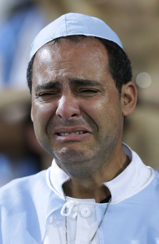 An Argentina supporter cries after the World Cup final soccer match between Germany and Argentina at the Maracana Stadium in Rio de Janeiro, Brazil, Sunday, July 13, 2014. Germany beat Argentina 1-0 to win the World Cup. (AP Photo/Victor R. Caivano)
