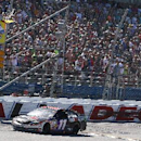 Denny Hamlin (11) takes the checkered flag under caution during the NASCAR Aaron's 499 Sprint Cup series auto race at Talladega Superspeedway, Sunday, May 4, 2014, in Talladega, Ala. (AP Photo/Jay Alley)