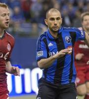 Toronto FC Richard Eckersley, left, races Montreal Impact's Marco Di Vaio for the ball during the first half of an MLS soccer game at Olympic Stadium in Montreal on Saturday, March 16, 2013. (AP Photo/The Canadian Press, Peter McCabe)