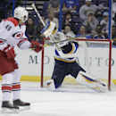 St. Louis Blues goalie Brian Elliott (1) makes a stick save on a shot from Carolina Hurricanes' Victor Rask (49) in the third period of a preseason NHL hockey game, Tuesday, Sept. 30, 2014 in St. Louis. The Blues beat the Hurricanes 3-1. (AP Photo/Tom Gannam)