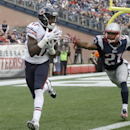 Chicago Bears wide receiver Alshon Jeffery (17) catches a touchdown pass in front of New England Patriots defensive back Malcolm Butler (21) in the second half of an NFL football game on Sunday, Oct. 26, 2014, in Foxborough, Mass The Associated Press