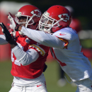 Kansas City Chiefs cornerback Marcus Cooper, right, defends Donnie Avery (17) during NFL football training camp Tuesday morning, Aug. 12, 2014, in St. Joseph. Mo The Associated Press