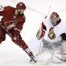 Ottawa Senators' Craig Anderson, right, makes a save on a shot by Arizona Coyotes' Lucas Lessio (38) during the third period of an NHL hockey game Saturday, Jan. 10, 2015, in Glendale, Ariz. The Senators defeated the Coyotes 5-1 The Associated Press