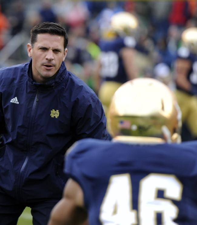 In this Nov. 2, 2013 file photo, Notre Dame defensive coordinator Bob Diaco works with his players prior to a NCAA college football game against Navy, in South Bend, Ind. Connecticut has hired Notre Dame defensive coordinator Bob Diaco as its football coach. The school announced the move early Thursday morning, Dec. 12, 2013