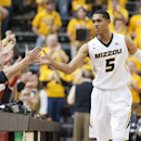 Missouri's Jordan Clarkson is congratulated by fans after his team upset No. 18 UCLA 80-71 in an NCAA college basketball game Saturday, Dec. 7, 2013, in Columbia, Mo The Associated Press