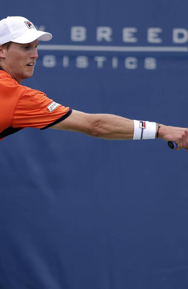 Andreas Seppi, of Italy, returns a shot against Yen-Hsun Lu, of Taiwan, during their match at the Winston-Salem Open tennis tournament in Winston-Salem, N.C., Thursday, Aug. 21, 2014